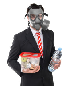 Survival concept business man with gas mask isolated on white